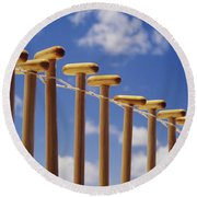 Paddles Hanging In A Row Round Beach Towel