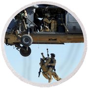 Pararescuemen Are Hoisted Into An Hh-60 Round Beach Towel