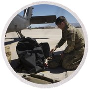 Pararescuemen Sorts Out His Gear Round Beach Towel
