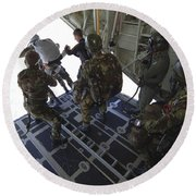 Paratroopers Jump From A C-130 Hercules Round Beach Towel by Andrew Chittock