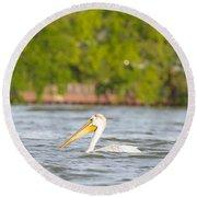 Pelican Drifting Along Round Beach Towel