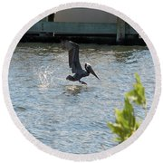 Pelican On The Waves Round Beach Towel