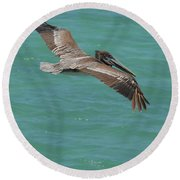 Pelican With His Wings Extended Over The Tropical Aruban Waters Round Beach Towel
