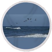 Pelicans Over The Atlantic Round Beach Towel