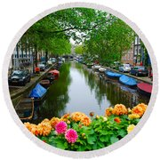 Picturesque View Amsterdam Holland Canal Flowers Round Beach Towel