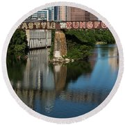 Picturesque View Of The Railroad Graffiti Bridge Over Lady Bird Lake As Canoes And Kayakers Paddle Under The Bridge On A Beautiful Summers Day Round Beach Towel