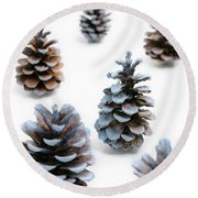Pine Cones Looking Like Christmas Trees On White Snowy Backgroun Round Beach Towel
