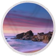 Pink Clouds And Rocky Headland Seascape Round Beach Towel