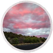 Pink Clouds Over Arizona Round Beach Towel