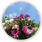 Pink Petunias In The Sky Round Beach Towel