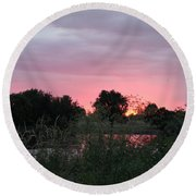 Pink Sunset With Green Riverbank Round Beach Towel