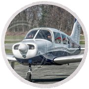Piper Pa28 I-cnpg Taxiing To The Runway Round Beach Towel