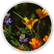 Poppies And Bluebells Round Beach Towel