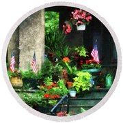 Porch With Geraniums And American Flags Round Beach Towel