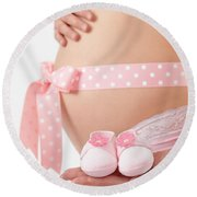Pregnant Woman Holding Pink Baby Shoes Round Beach Towel
