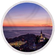 Purple Light On The Adriatic Sea After Sundown With Lights On Pi Round Beach Towel