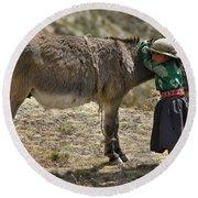 Quechua Girl Hugging His Donkey. Republic Of Bolivia. Round Beach Towel