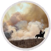 Rancher Starting A Controlled Burn Round Beach Towel