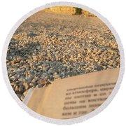 Reading A Book On Pebble Beach Round Beach Towel