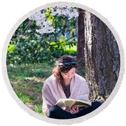 Reading Beneath The Cherry Blossoms Round Beach Towel