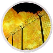 Realistic Fiery Explosion Behind Restricted Area Barbed Wire Fence Round Beach Towel