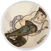 Reclining Woman With Green Stockings Round Beach Towel