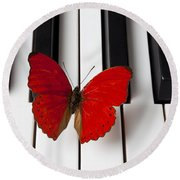 Red Butterfly On Piano Keys Round Beach Towel by Garry Gay