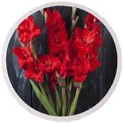 Red Gladiolus In Striped Vase Round Beach Towel