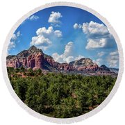 Red Hills And Green Tress Round Beach Towel