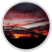 Red Skies At Pleasure Island Bridge Round Beach Towel