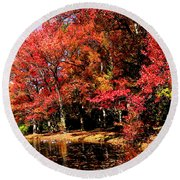 Red Trees By Lake Round Beach Towel