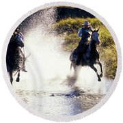 Riders In A Creek Round Beach Towel
