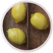 Ripe Lemons In Wooden Tray Round Beach Towel