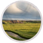 River Below The Clouds Round Beach Towel