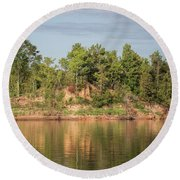 Riverbank Along The Red Round Beach Towel
