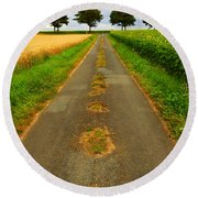 Road In Rural France Round Beach Towel