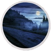 Road Near Foggy Forest In Mountains At Night Round Beach Towel