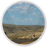 Road Through New Mexico Desert High Noon Round Beach Towel