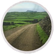Road Through The Pastrues Of Terceira  Round Beach Towel by Kelly Hazel