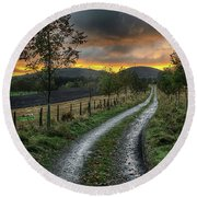 Road To The Sunset Round Beach Towel