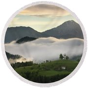 Rolling Fog At Sunrise In The Skofjelosko Hills With St Thomas C Round Beach Towel
