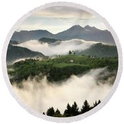 Rolling Fog At Sunrise With Mountains Of Kamnik Savinja Alps At  Round Beach Towel