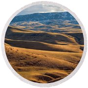 Rolling Foothills And The Bighorn Mountains Round Beach Towel