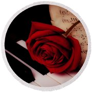 Rose With Sheet Music On Piano Keys Round Beach Towel