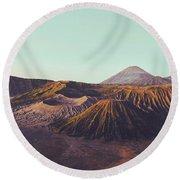 Rugged Mountainous Terrain Mount Bromo At Sunrise Round Beach Towel