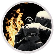Russian Soldier Statue In Snow And Fire Round Beach Towel