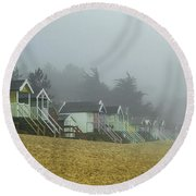 Sand And Huts And Fog Round Beach Towel