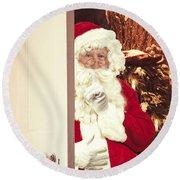Santa Claus At Open Christmas Door Round Beach Towel