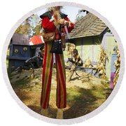 Scarecrow Walking On Stilts Round Beach Towel