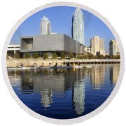 Sculling By The Tampa Bay Art Center Round Beach Towel